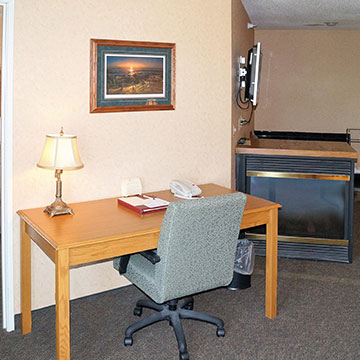 Are there any facilities for business travelers in the rooms?
