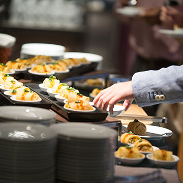 How early should food and beverage planning be done to host an event?